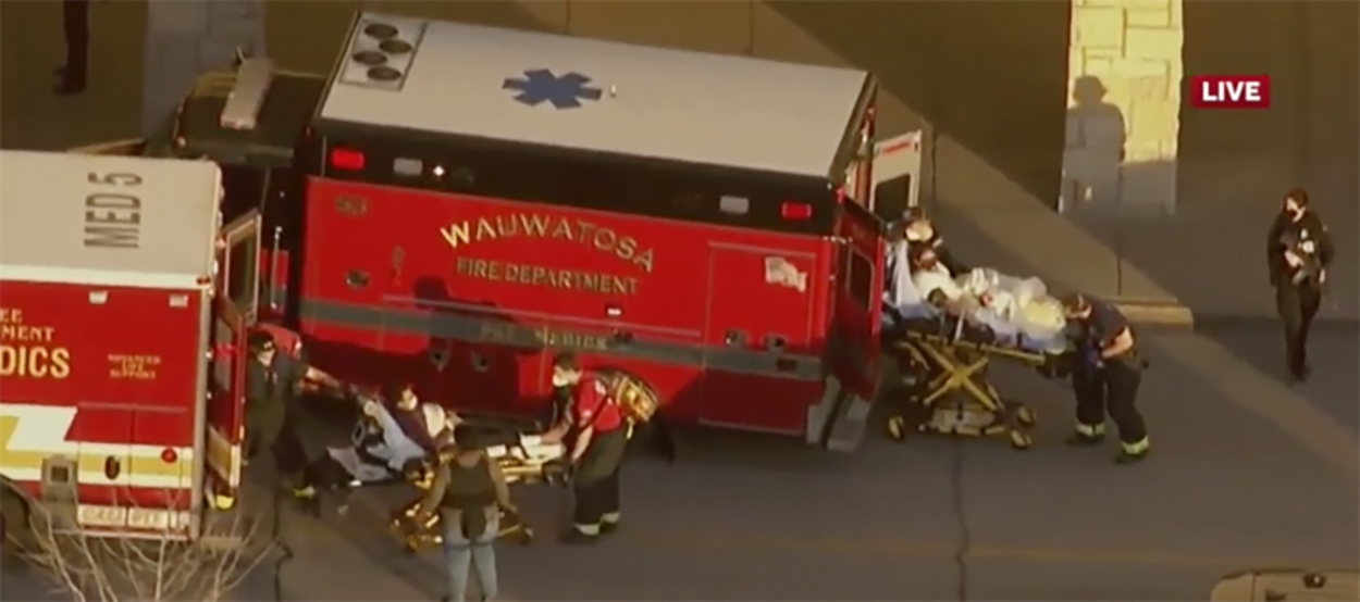 In this image taken from video provided by WISN-TV, emergency crews place two people in waiting ambulances at the Mayfair Mall in Wauwatosa, Wis., on Friday, Nov. 20, 2020. A police dispatcher says officers are responding to  a very active situation  at the suburban Milwaukee mall. The dispatcher said she could not immediately provide further details. Witnesses told WISN-TV that they heard what they believed were eight to 12 shots.