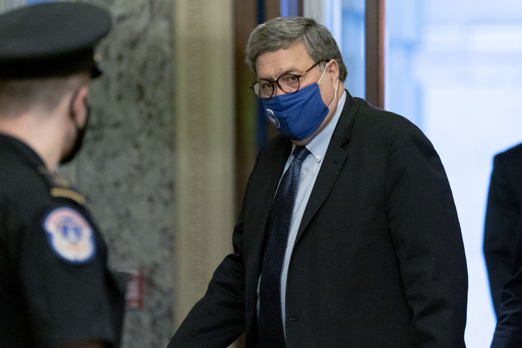 Attorney General William Barr wears a protective mask while arriving at the U.S. Capitol in Washington, D.C., U.S., on Monday, Nov. 9, 2020.