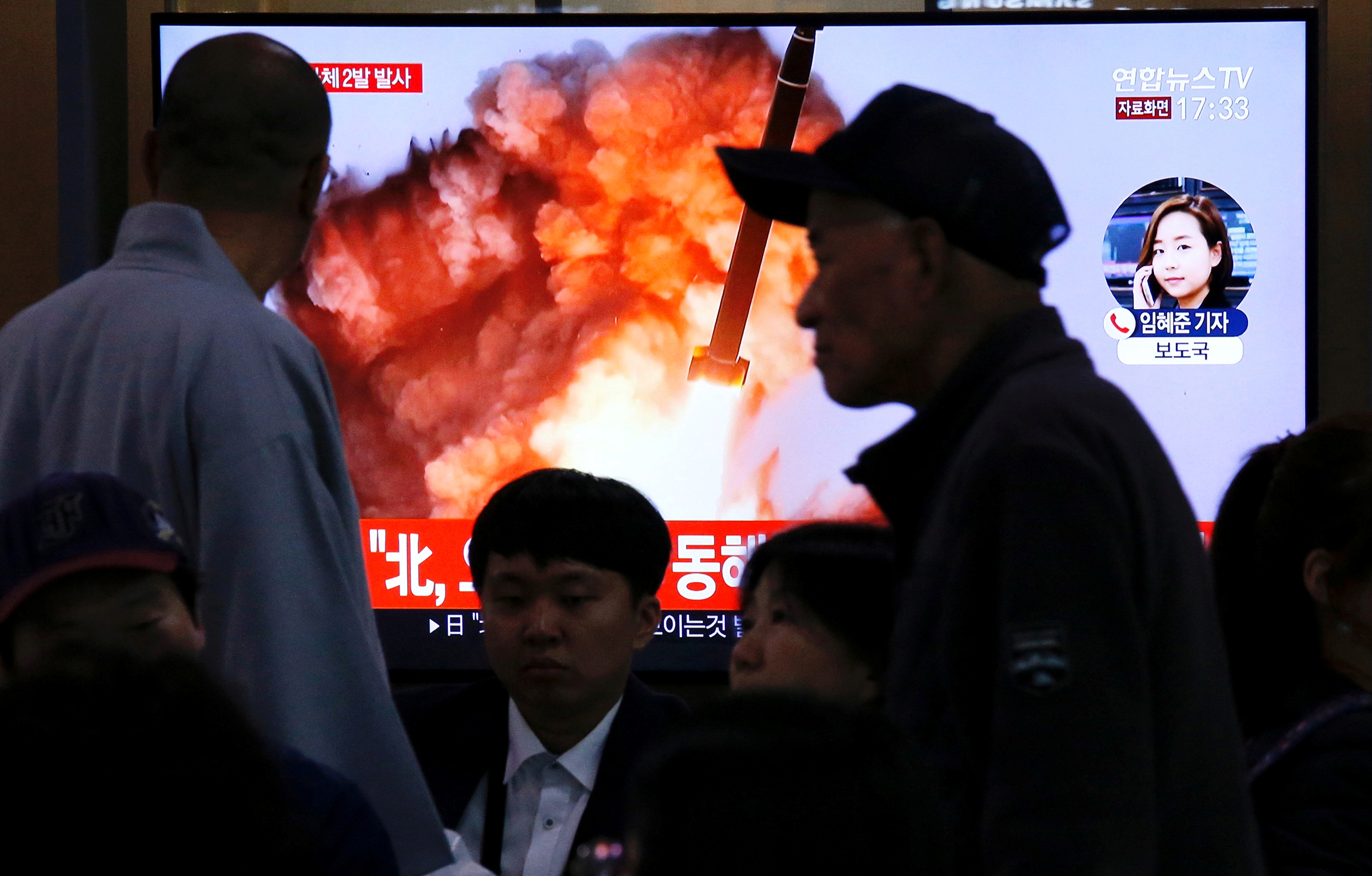 People watch a TV broadcast showing a file footage for a news report on North Korea firing two projectiles—possibly missiles—into the sea between the Korean peninsula and Japan, in Seoul on Oct. 31, 2019