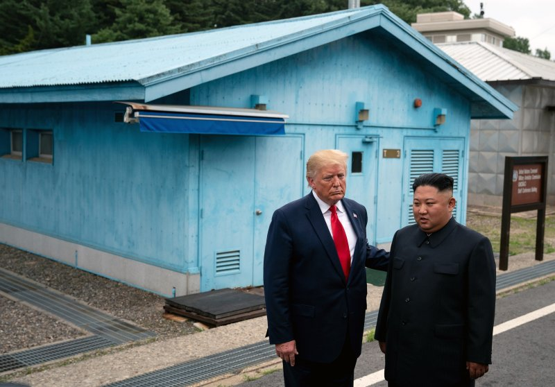 President Donald Trump and North Korean leader Kim Jong-un stand on the South Korean side of the Demilitarized Zone between on June 30, 2019