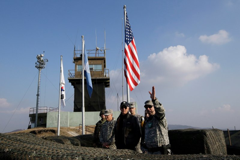 On Dec. 7, 2013, then U.S. Vice President Joe Biden, center, visits Observation Post Ouellette inside the Demilitarized Zone, which has separated the two Koreas since the Korean War