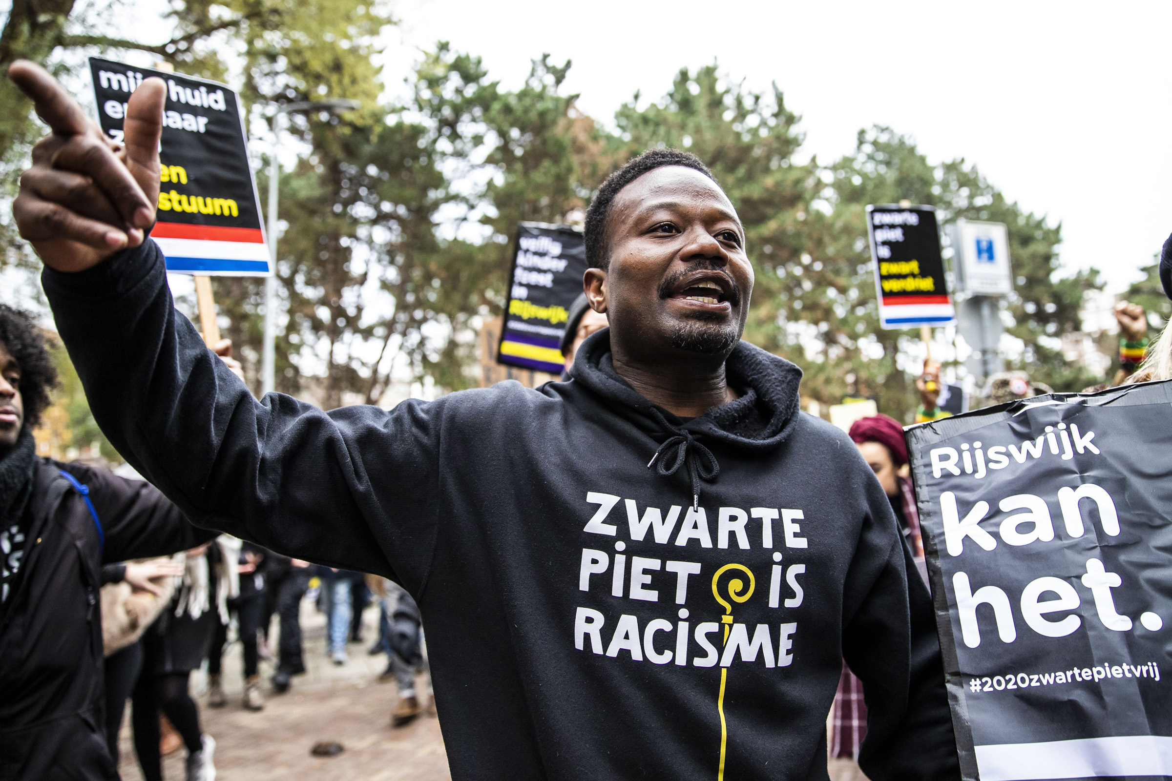 Dutch anti-discrimination activist Jerry Afriyie (C), leader of the 'Kick Out Zwarte Piet' (Kick Out Black Pete) movement, during a protest in Rijswijk, the Netherlands, on Nov. 23, 2019.