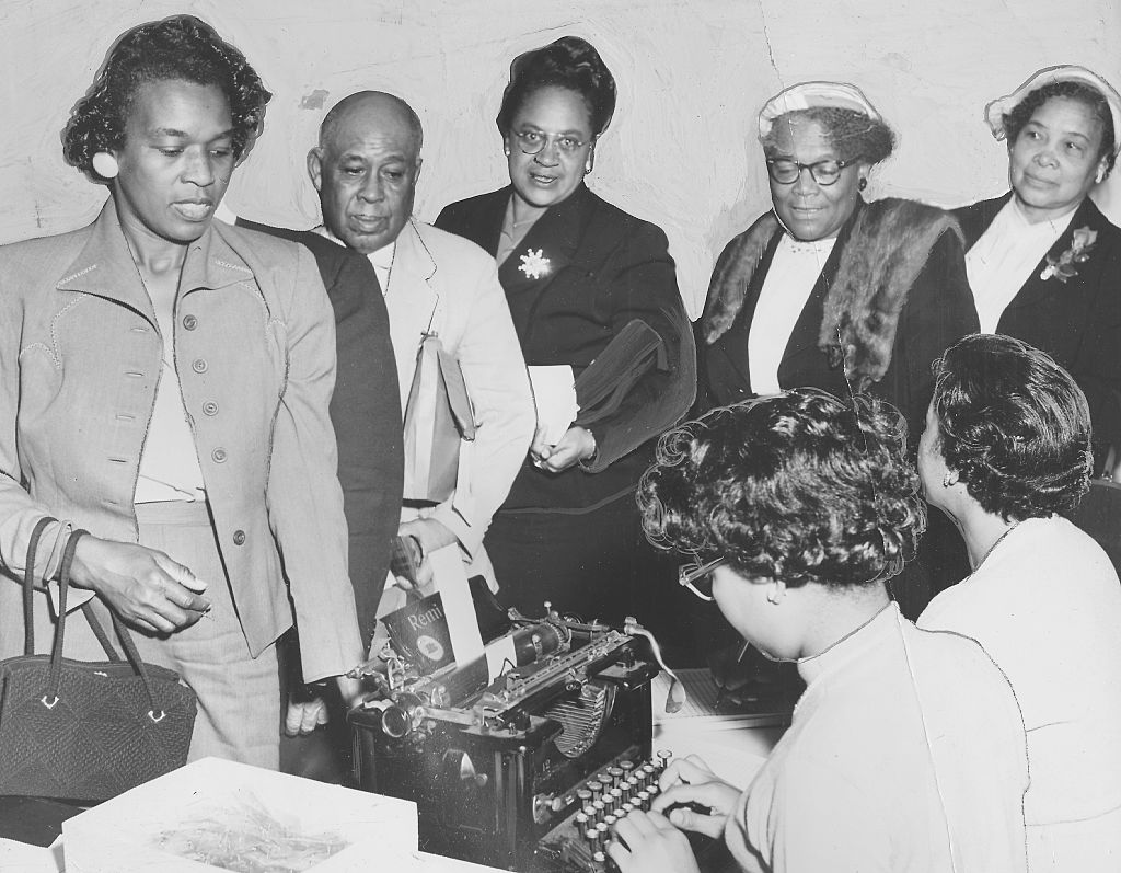 A group of Black men and women registering to vote before the deadline in the presidential and congressional elections, Oct. 4, 1958.