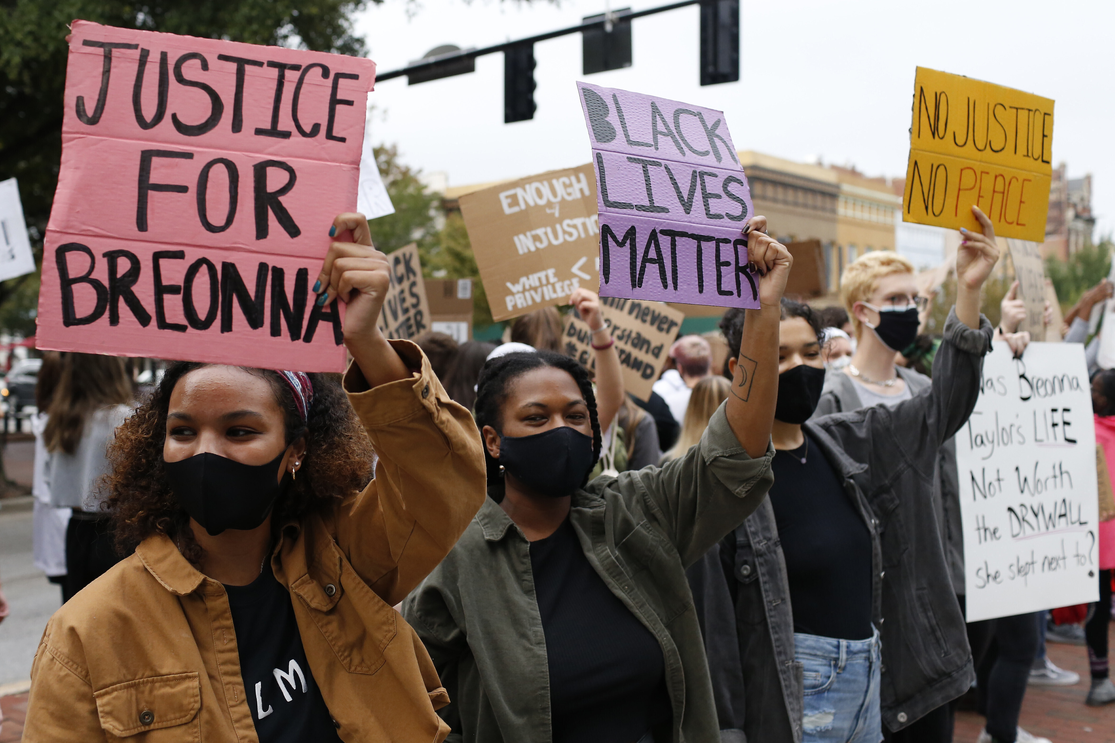 In this Sept. 25, 2020, file photo, University of Georgia students lead a Black Lives Matter protest in downtown in memory of Breonna Taylor in Athens, Ga.