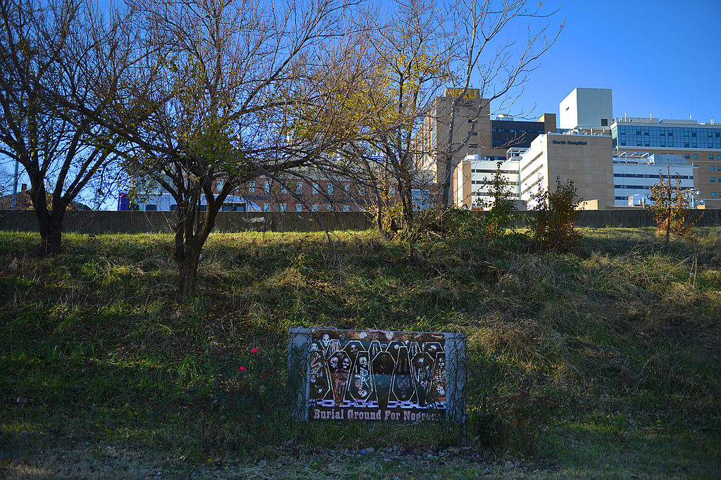 A sign is posted at the site of the African Burial Ground on Nov. 18, 2013, in Richmond, Va. Many of Richmond's enslaved people were buried in graves that now border Interstate 95.