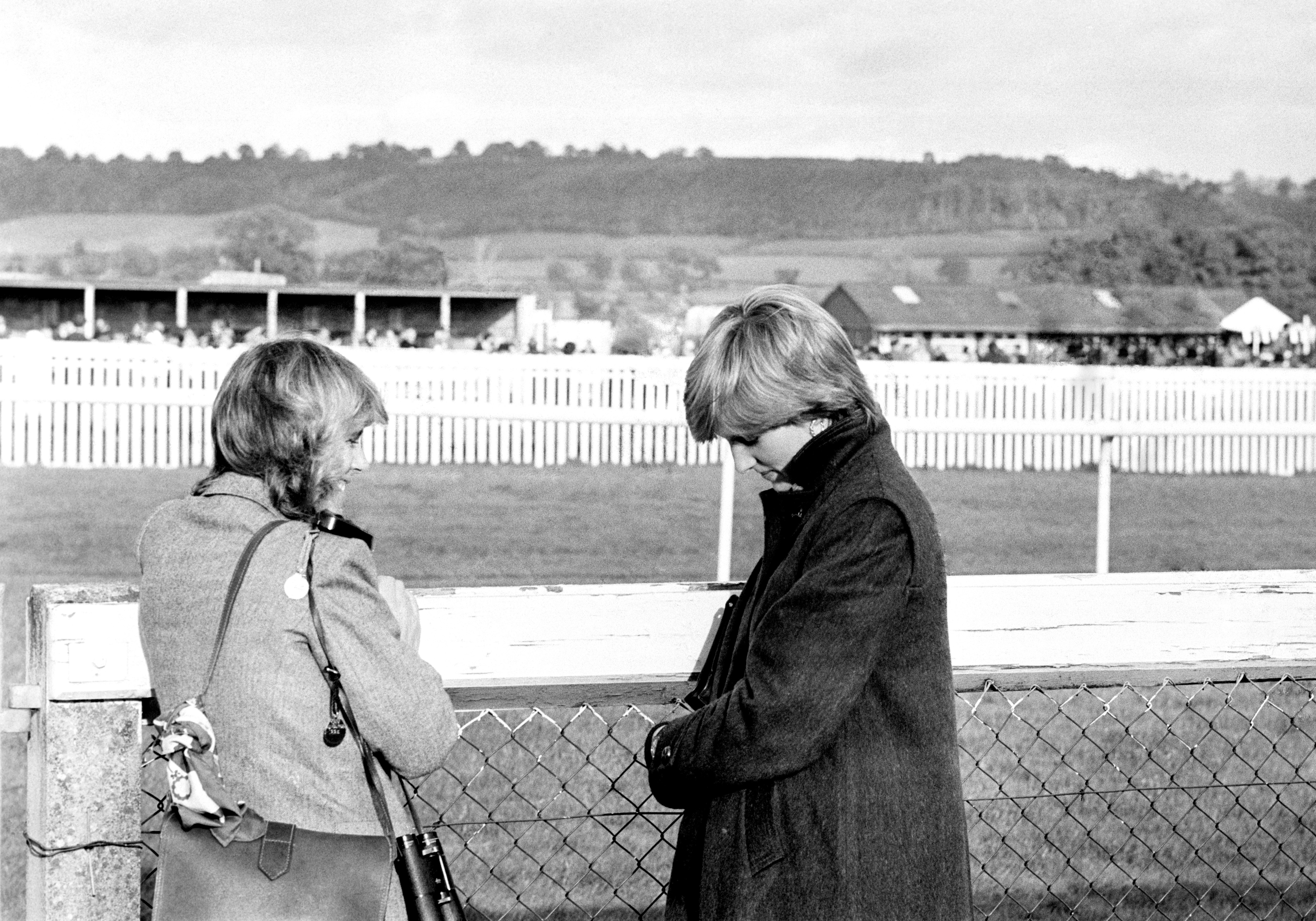 Camilla Parker-Bowles (left) and Lady Diana Spencer (later the Princess of Wales) at Ludlow racecourse to watch the Amateur Riders Handicap Steeplechase in which the Prince was competing