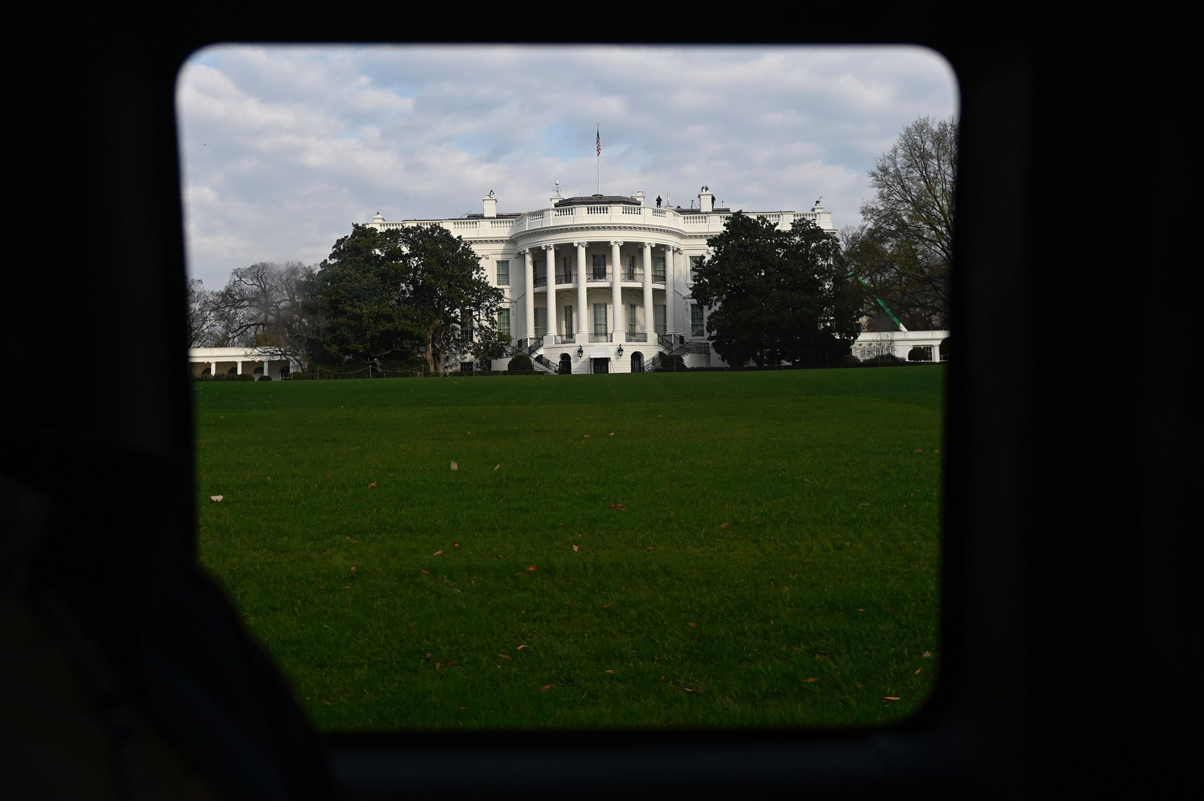 The White House is seen through a vehicle in the presidential motorcade in Washington, on Nov. 21, 2020.