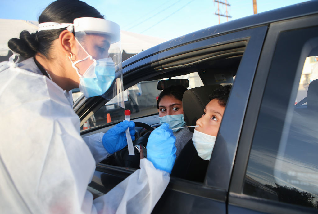 Frontline healthcare worker Joanne Grajeda administers a nasal swab test at a drive-in testing site amid a surge of COVID-19 cases on Nov. 13, 2020 in El Paso, Texas.