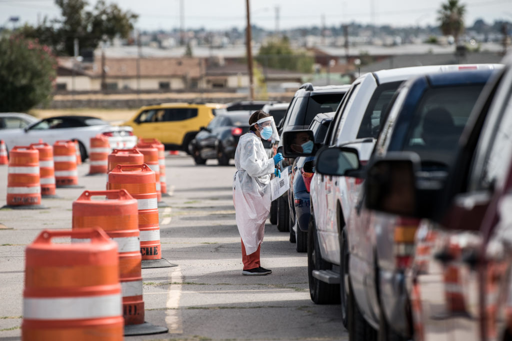 An attendant talks to a person waiting in their car at a coronavirus testing site at Ascarate Park on October 31, 2020 in El Paso, Texas.