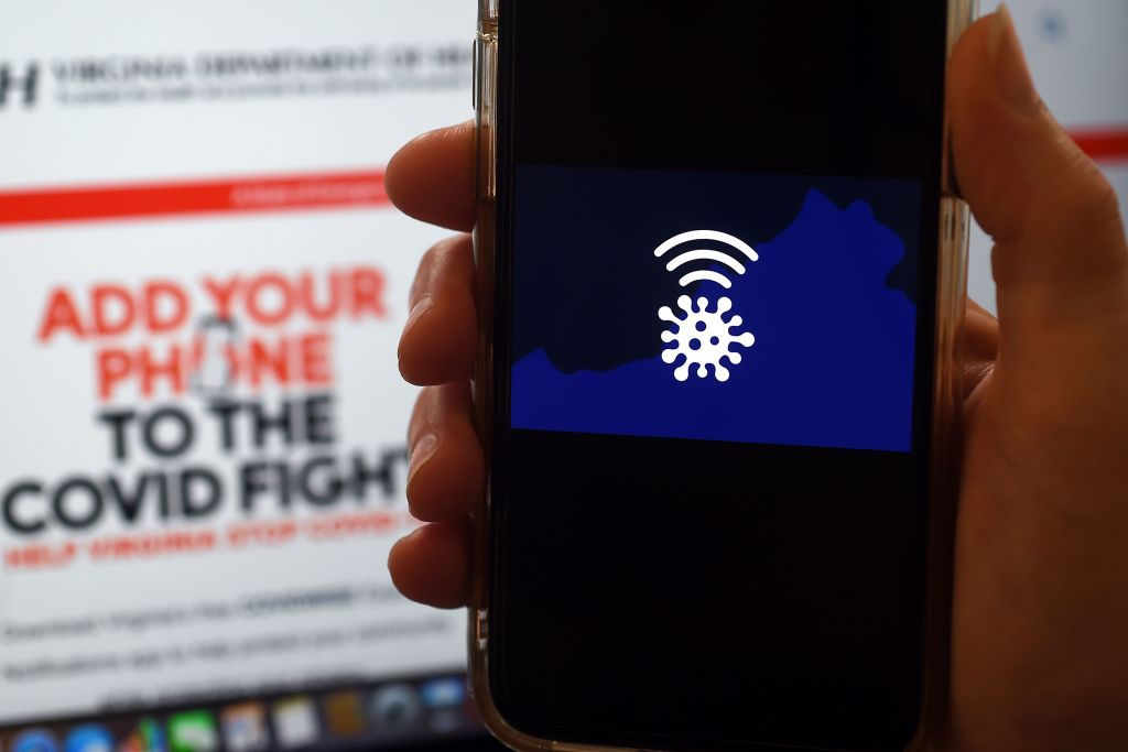 In this photo illustration a COVIDWISE logo is displayed on a mobile phone screen on August 6, 2020, in Arlington, Virginia, amid the novel coronavirus pandemic.