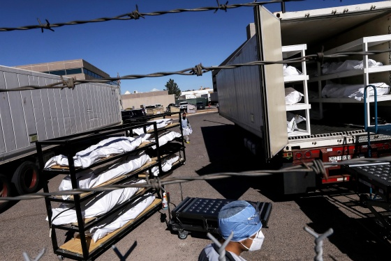 Bodies loaded into a refrigerated temporary morgue trailer in El Paso, Texas, on Nov. 16