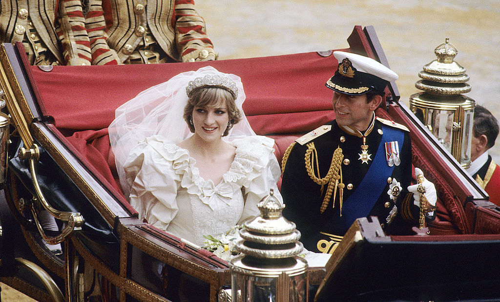 Prince Charles, Prince of Wales and Diana, Princess of Wales, wearing a wedding dress designed by David and Elizabeth Emanuel and the Spencer family Tiara, ride in an open carriage, from St. Paul's Cathedral to Buckingham Palace, following their wedding on July 29, 1981 in London, England.