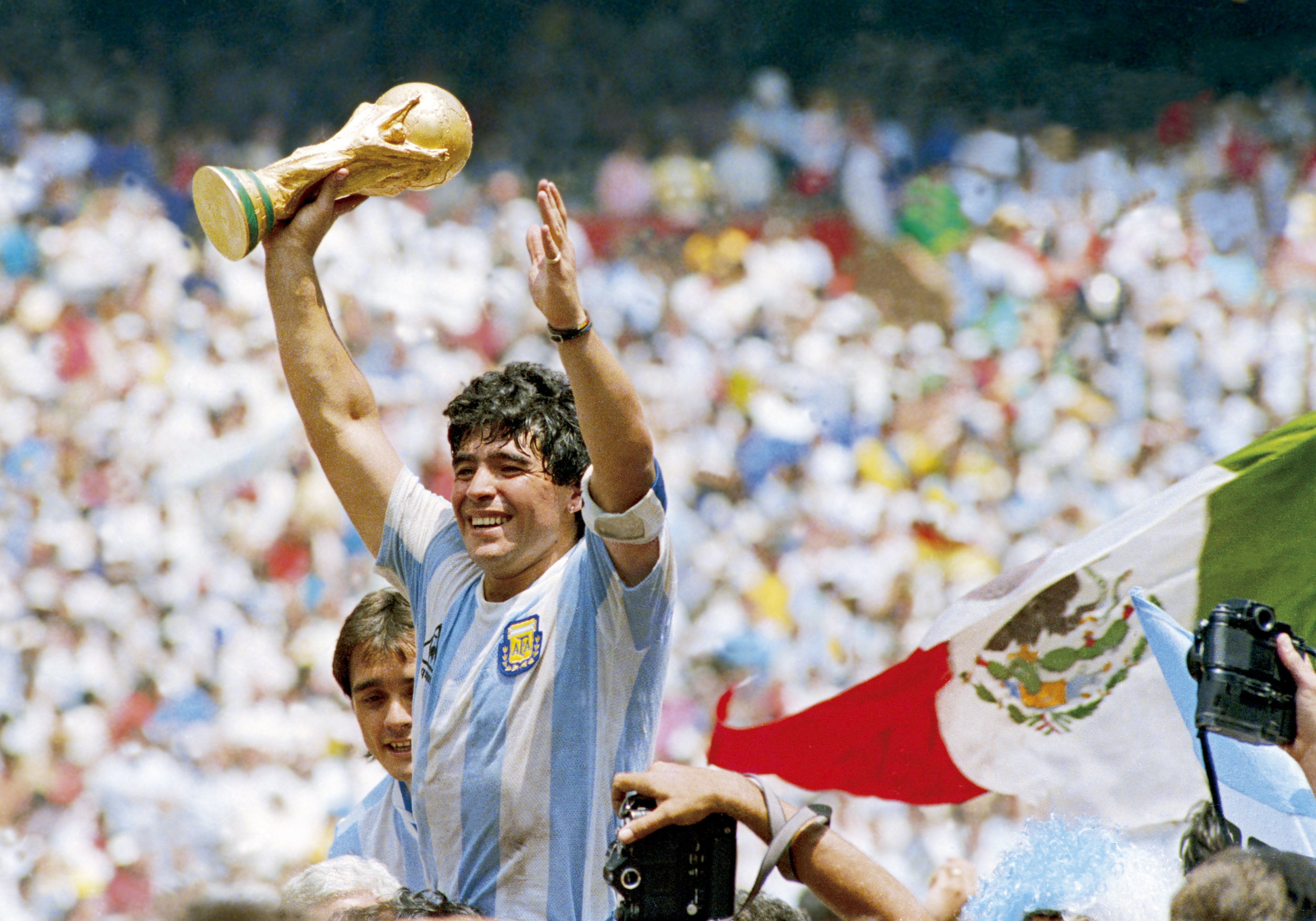 Diego Maradona holds the World Cup trophy after defeating West Germany 3-2 during the 1986 FIFA World Cup Final match on June 29, 1986 in Mexico City, Mexico.