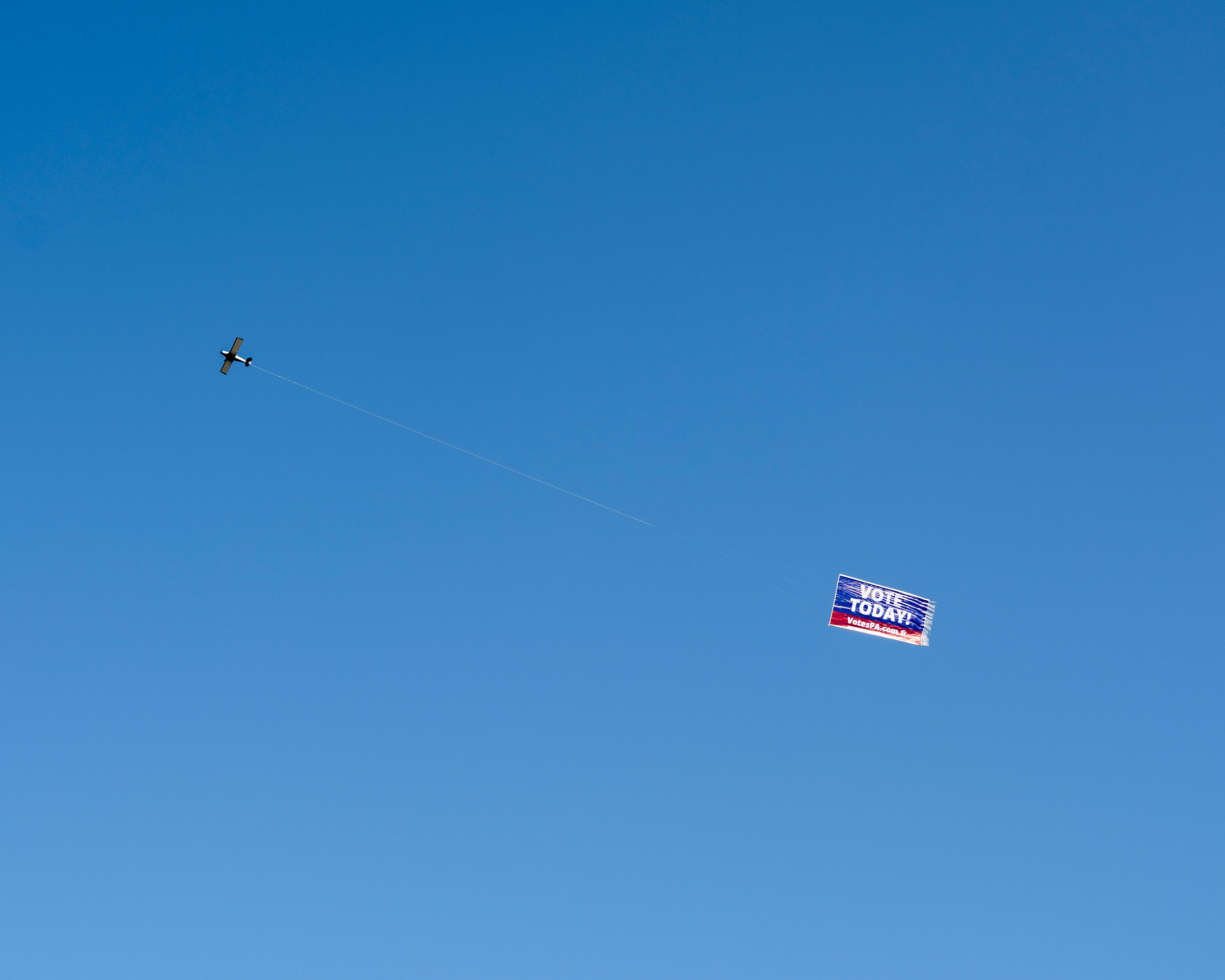 An airplane flies over Erie, Penn. to encourage people to vote.
