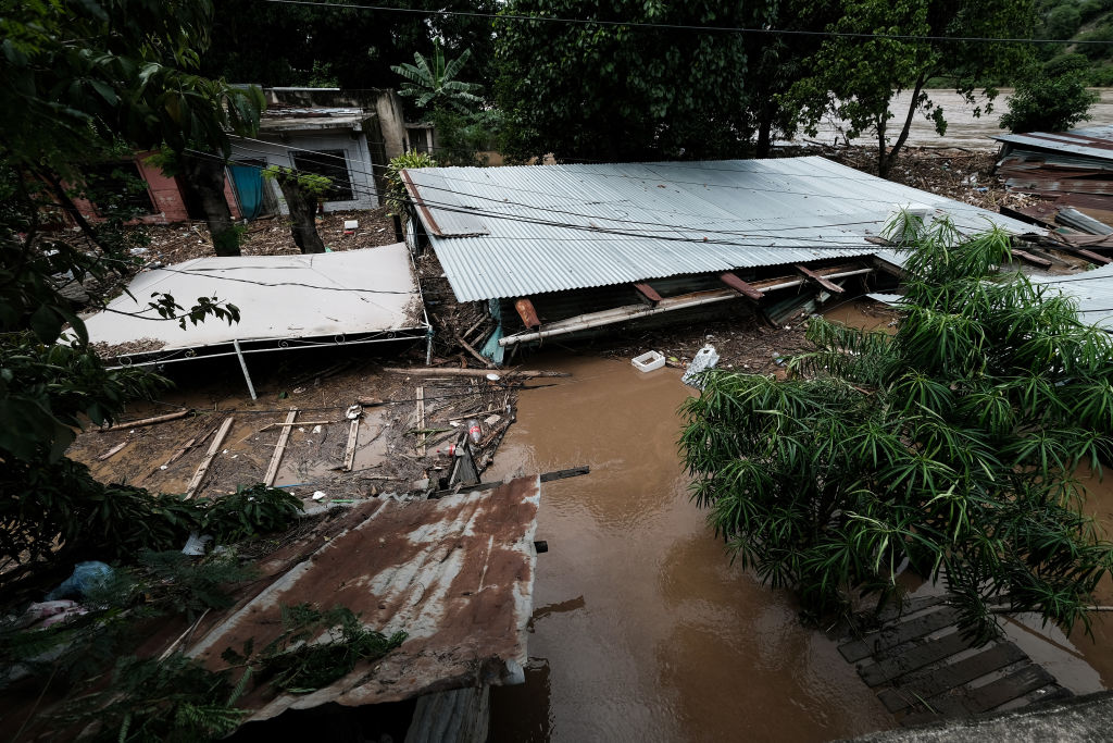 The debris of a home remain under the water after the flow of Chamelecon river increased due to the rain caused by tropical storm Eta on November 05, 2020 in Cortes, Honduras.