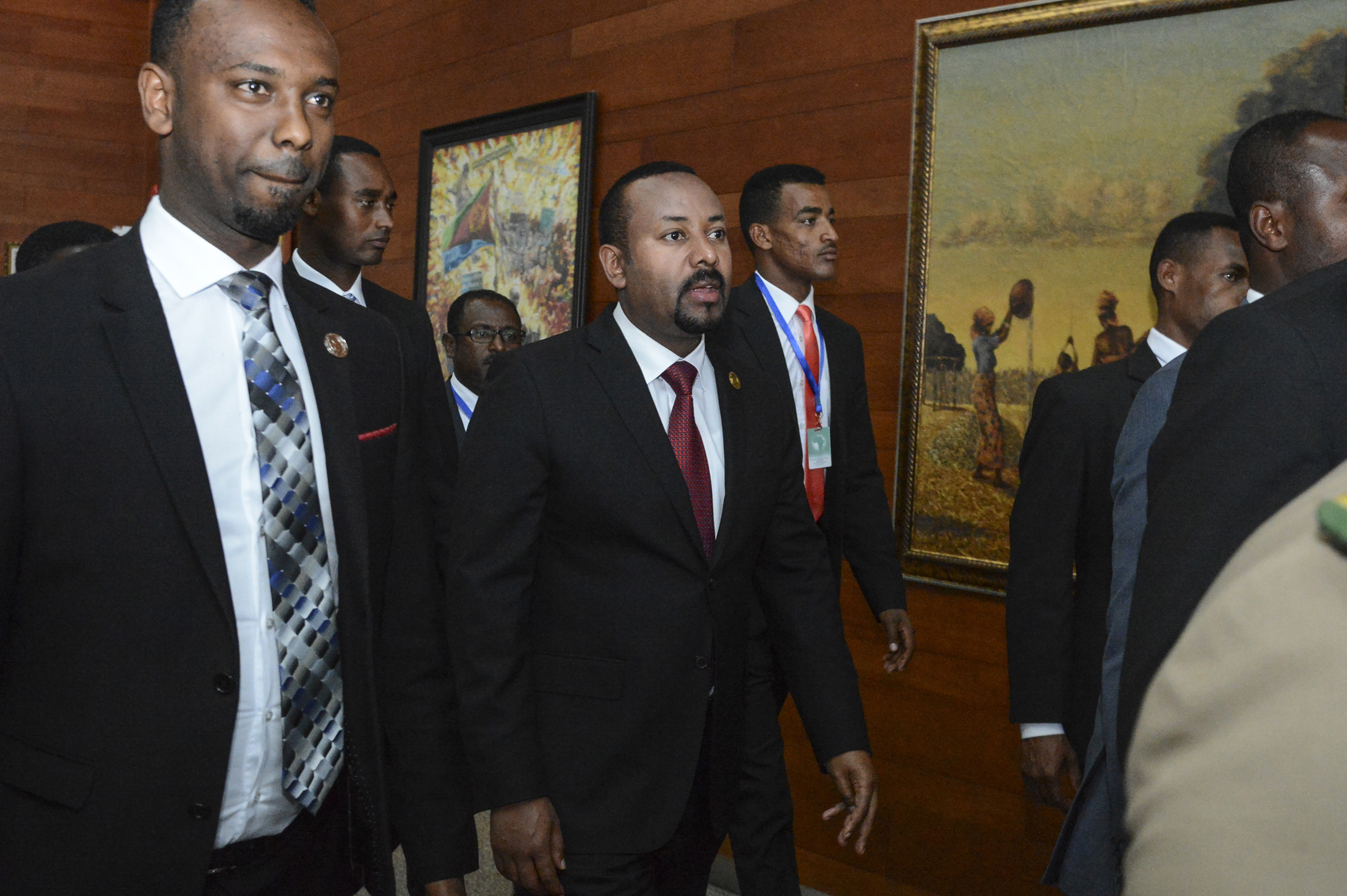 Ethiopia's Prime Minister Abiy Ahmed, center, arrives for the opening session of the 33rd African Union Summit in Addis Ababa, Ethiopia, in Feb. 2020.