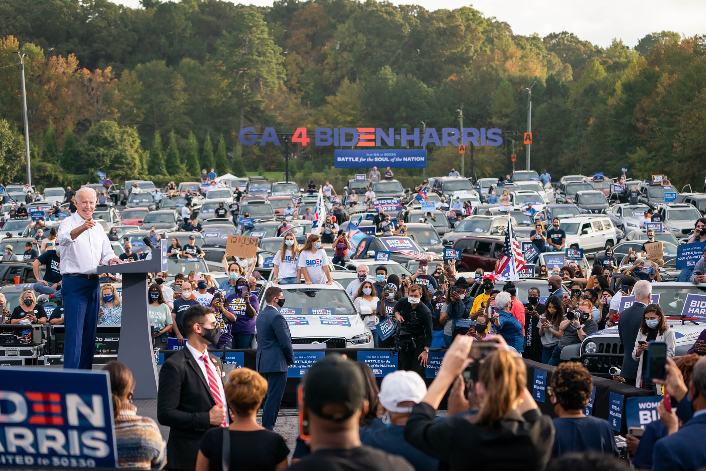 Biden interacts with voters at a car rally in Georgia