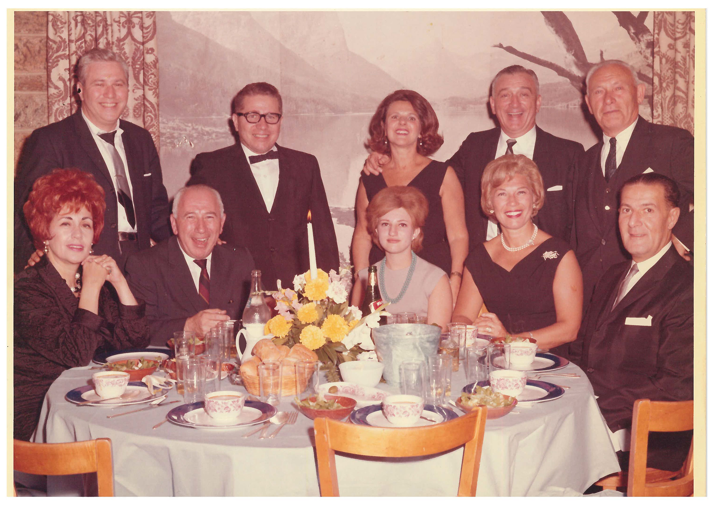 Torron, then 18 (bottom row center), seated next to her father Benjamin at a cousin's bar mitzvah in 1964; her family discovered the photo after being contacted by TIME.