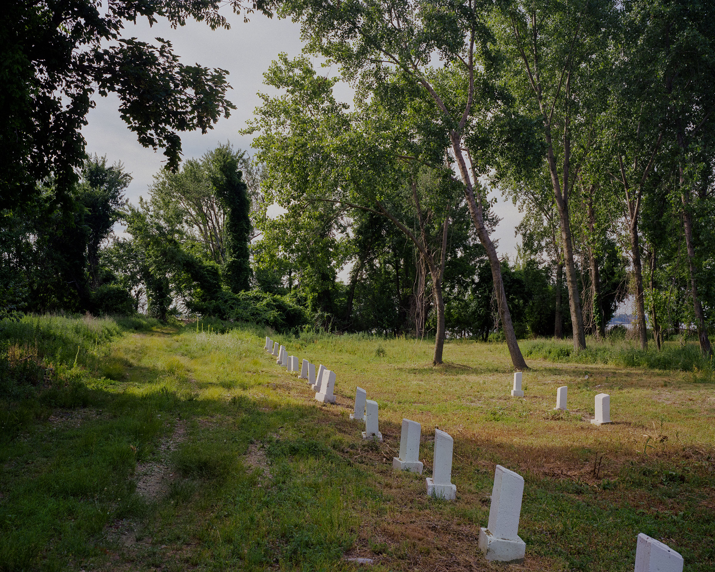 The first known AIDS victims are buried together on the southern end of Hart Island.