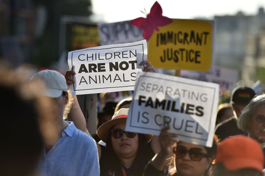 Critics of U.S. government policy that separates children their parents when they cross the border illegally from Mexico protest during a 'Families Belong Together March', in downtown Los Angeles on June 14, 2018.