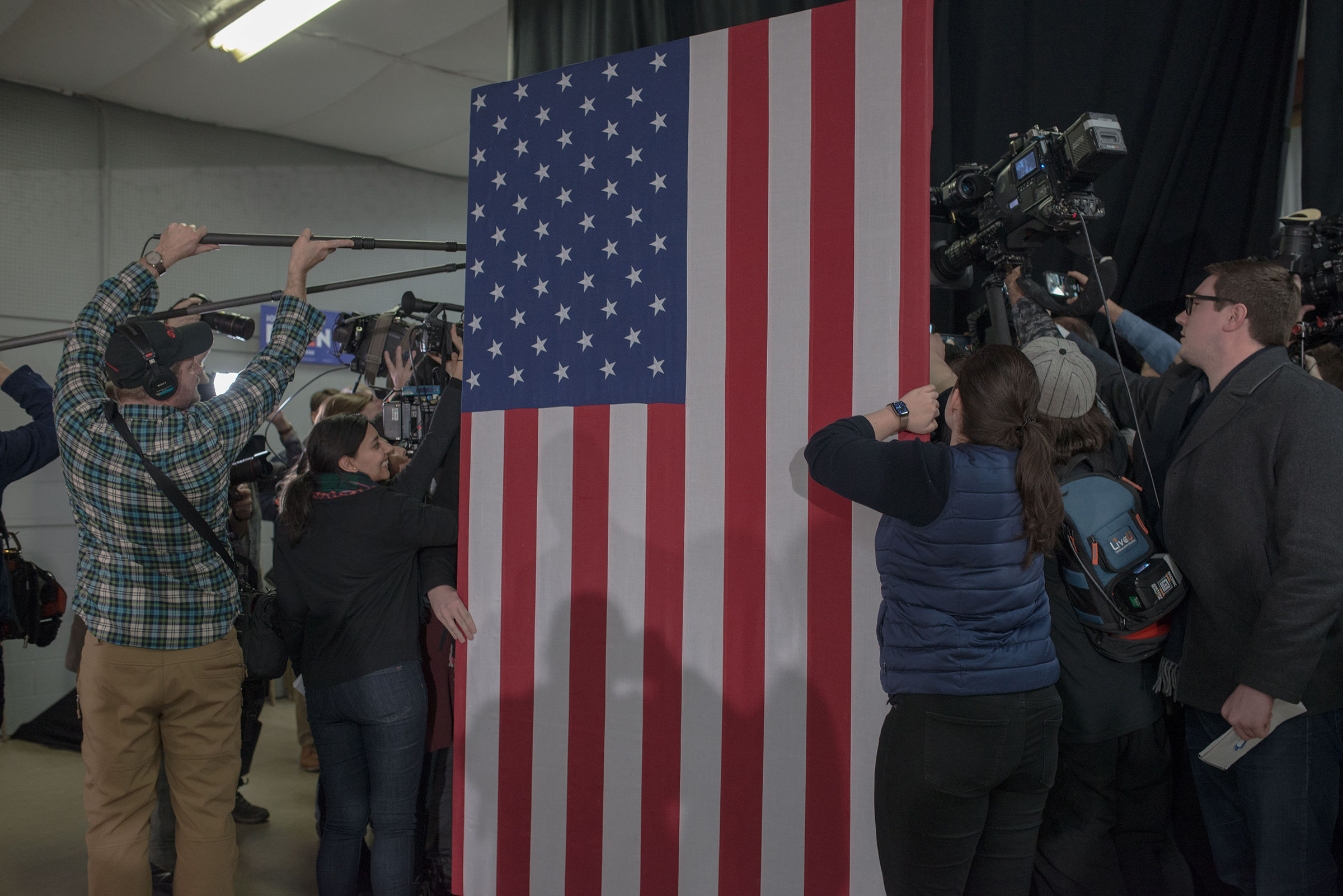 Journalists swarm Joe Biden behind an American flag in Mason City, Iowa, on Jan. 22, 2020.