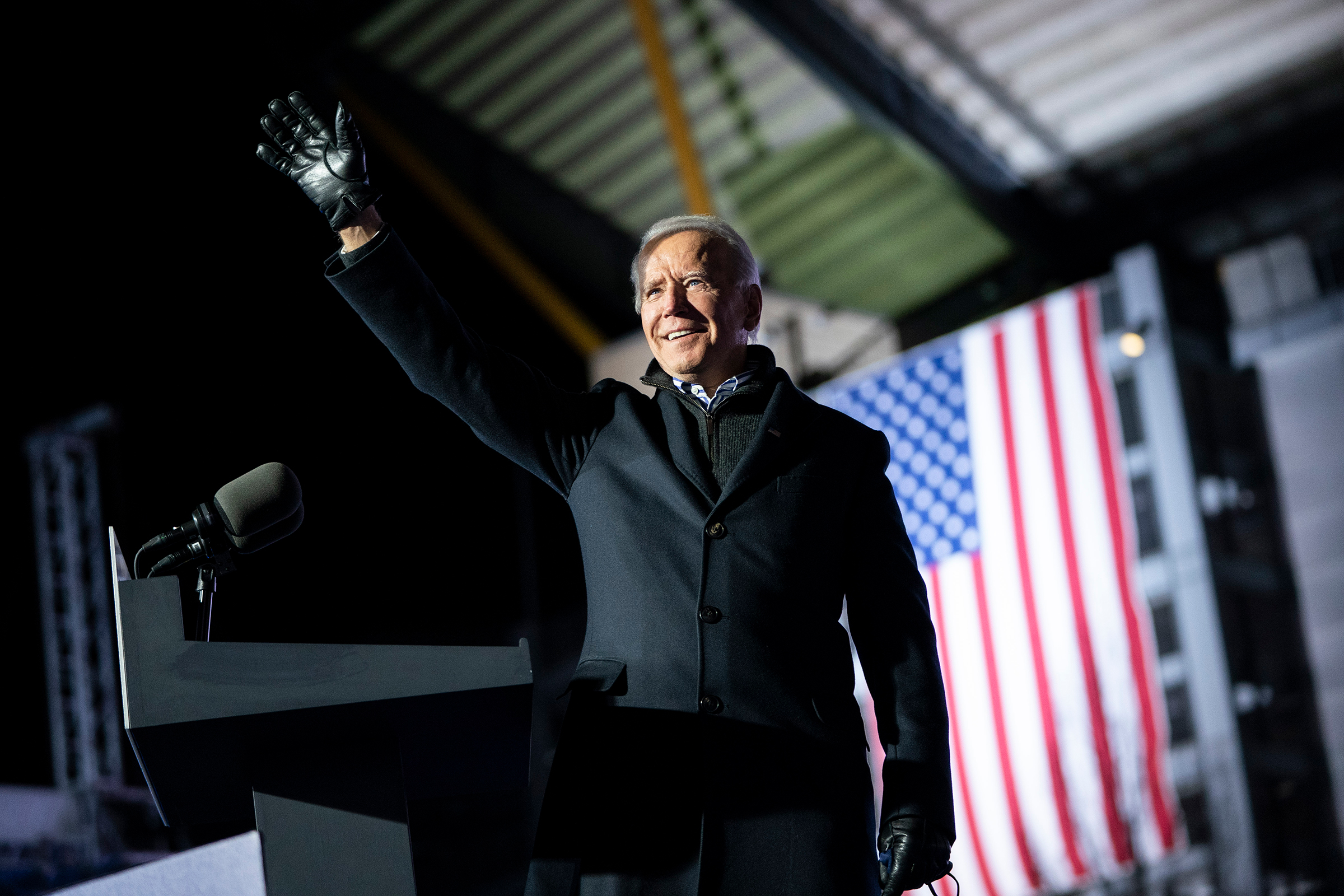 Joe Biden waves to the crowd as he arrives at a drive-in campaign rally at Heinz Field in Pittsburgh on Nov. 2, 2020.