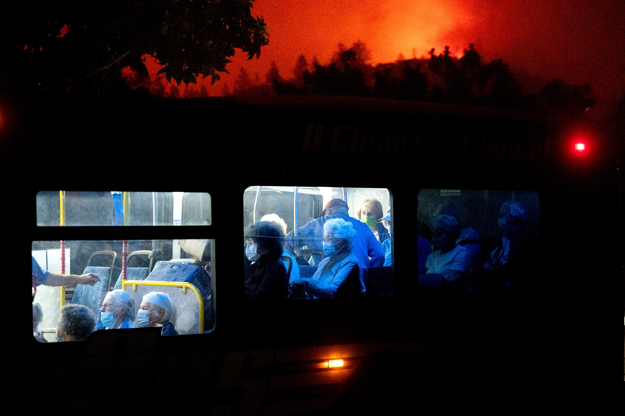 Residents of the Oakmont Gardens senior home evacuate on a bus as the Shady Fire approaches in Santa Rosa Calif., on Sept. 28, 2020.