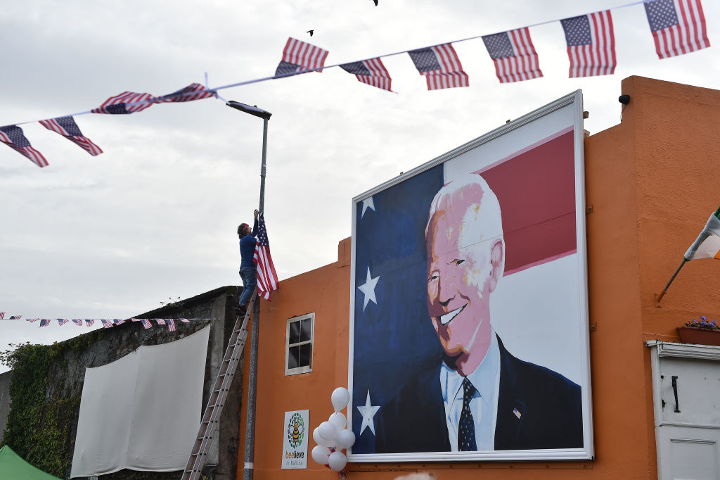 Locals hang out American flags and bunting as they celebrate in anticipation of Joe Biden being elected as the next U.S. President in Ballina, Ireland, on Nov. 7, 2020. Joe Biden whose distant relatives hail from the County Mayo town of Ballina has visited the town twice before as the former Vice President.