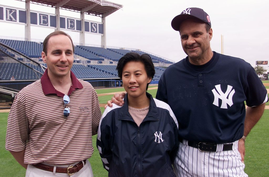 New York Yankees' general manager Brian Cashman, Kim Ng and manager Joe Torre (l. to R.), at announcement of Ng's promotion to vice president and assistant general manager.