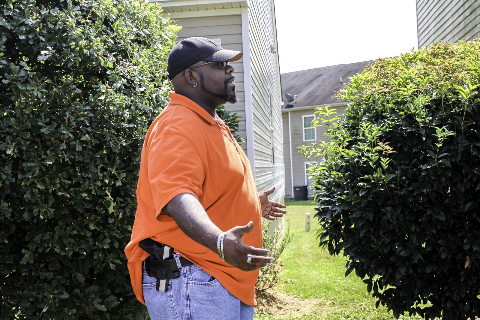 Luther Thompson, 41, poses with his firearm outside his Cartersville, Ga. home.