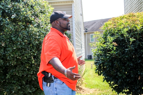 Luther Thompson, 41, poses with his firearm outside his Cartersville, Ga. home on Sept. 6, 2020.