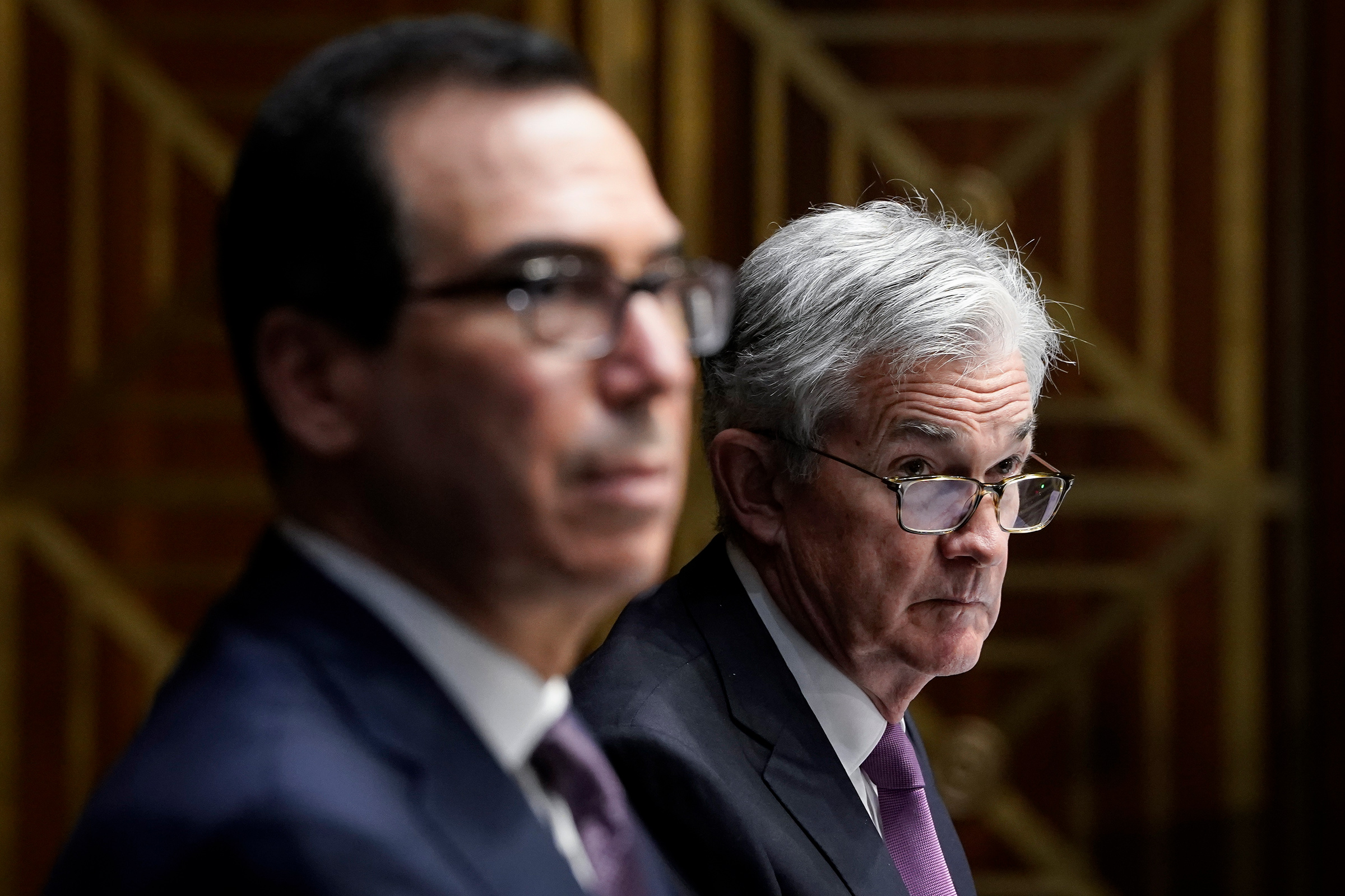 Treasury Secretary Steven Mnuchin and Federal Reserve Board Chairman Jerome Powell testify during a Senate Banking Committee hearing on Capitol Hill on Sept. 24