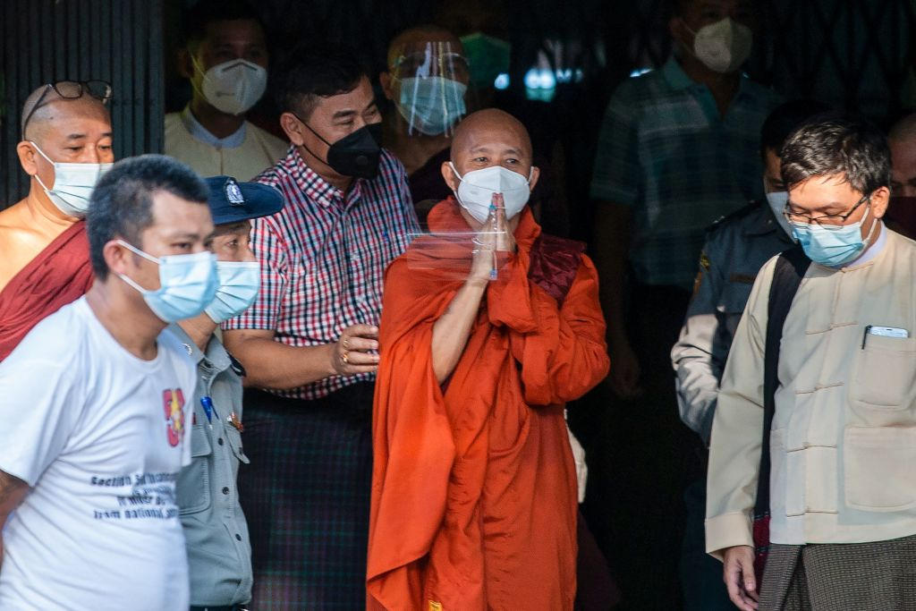 Buddhist monk Wirathu (2nd R) gestures to his followers before turning himself in at a police station in Yangon, Myanmar on Nov. 2, 2020.