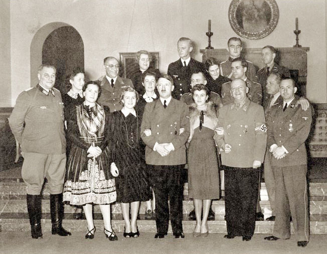 Adolf Hitler (1889 - 1945) with guests at at his residence on Dec. 31, 1939. Gerda Bormann is in the back row, fourth from left.