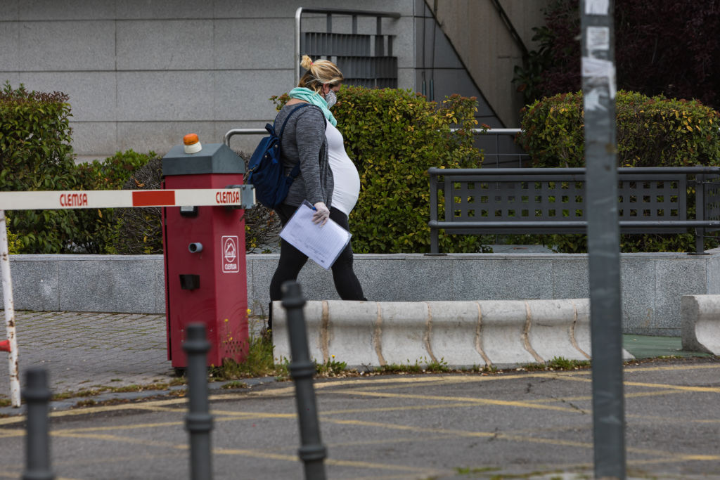 A pregnant woman wearing a face mask is seen at the La Paz University Hospital in Madrid, Spain on April 14, 2020.