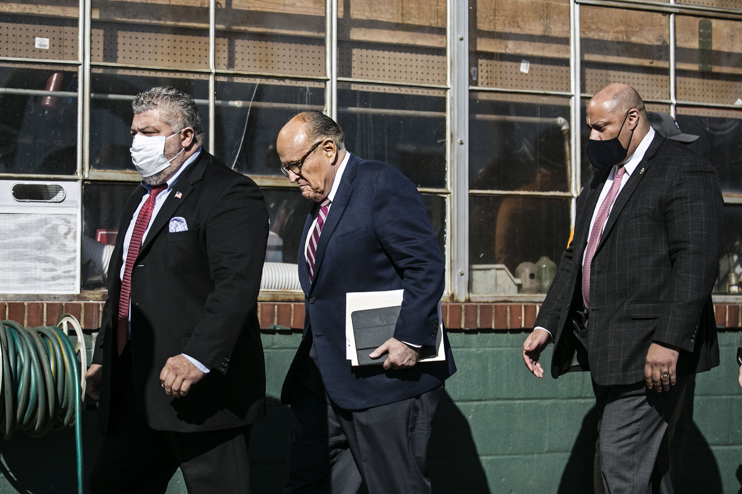 Rudy Giuliani arrives to a news conference in the parking lot of Four Seasons Total Landscaping in Philadelphia, on Nov. 7.