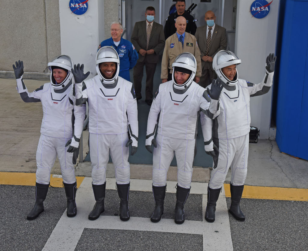 NASA astronauts; mission specialist Shannon Walker, vehicle pilot Victor Glover, commander Mike Hopkins and mission specialist from the Japan Aerospace Exploration Agency (JAXA), astronaut Soichi Noguchi; walk out of the Operations and Checkout Building November 15, 2020 on their way to the SpaceX Falcon 9 rocket with the Crew Dragon spacecraft on launch pad 39A at the Kennedy Space Center on November 15, 2020 in Cape Canaveral, Florida.