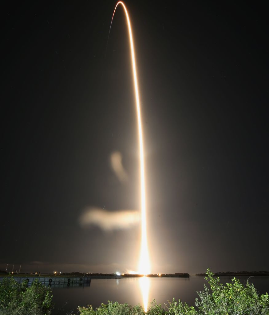 A SpaceX Falcon 9 rocket streaks toward space in this time exposure at liftoff from launch complex 39A at the Kennedy Space Center in Florida on Nov. 15, 2020. NASA's SpaceX Crew-1 mission is the first crew rotation mission of the SpaceX Crew Dragon spacecraft and Falcon 9 rocket to the International Space Station as part of the agency's Commercial Crew Program.