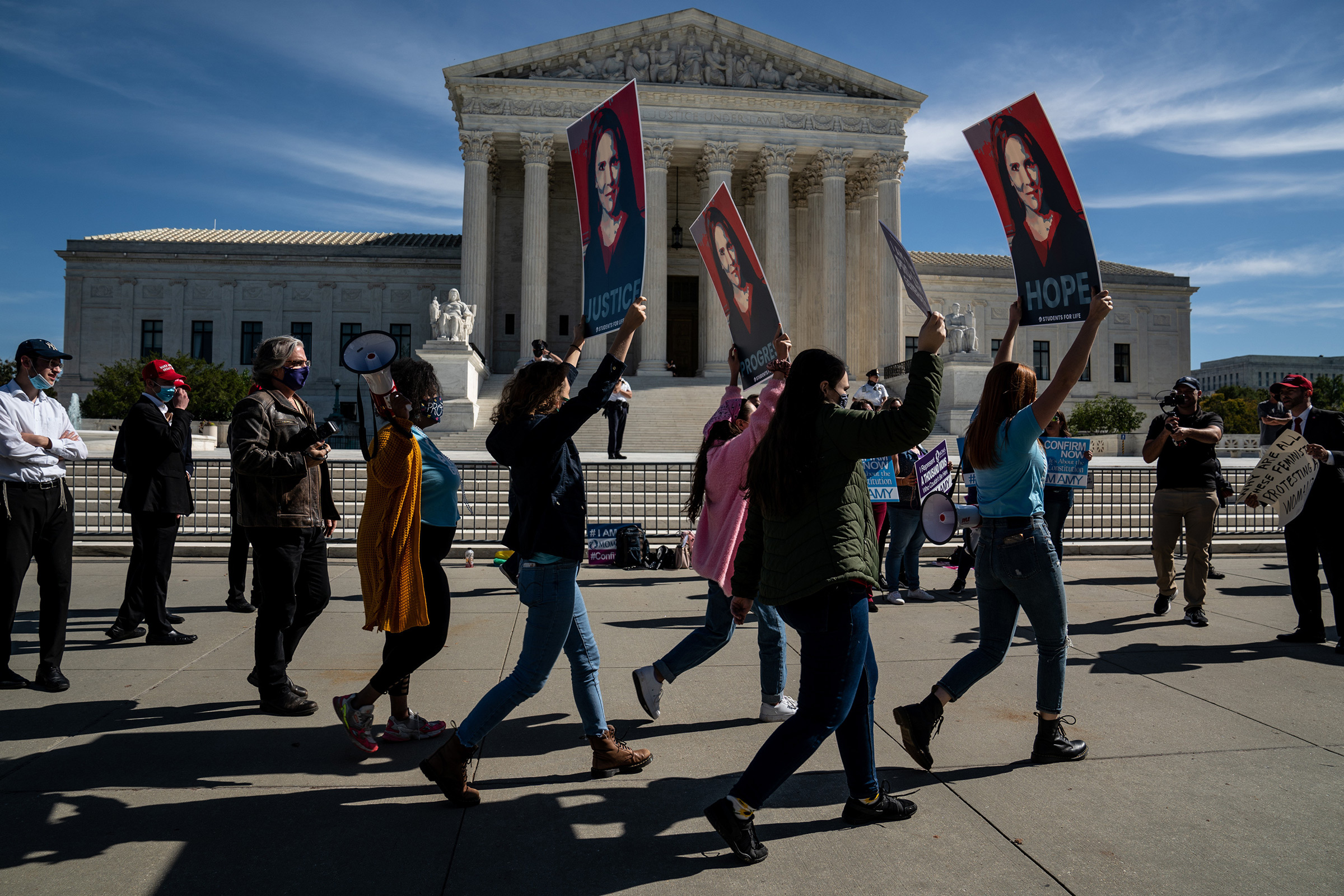 Supporters of Judge Amy Coney Barrett stand outside the Supreme Court in Washington, D.C., on Oct. 14.