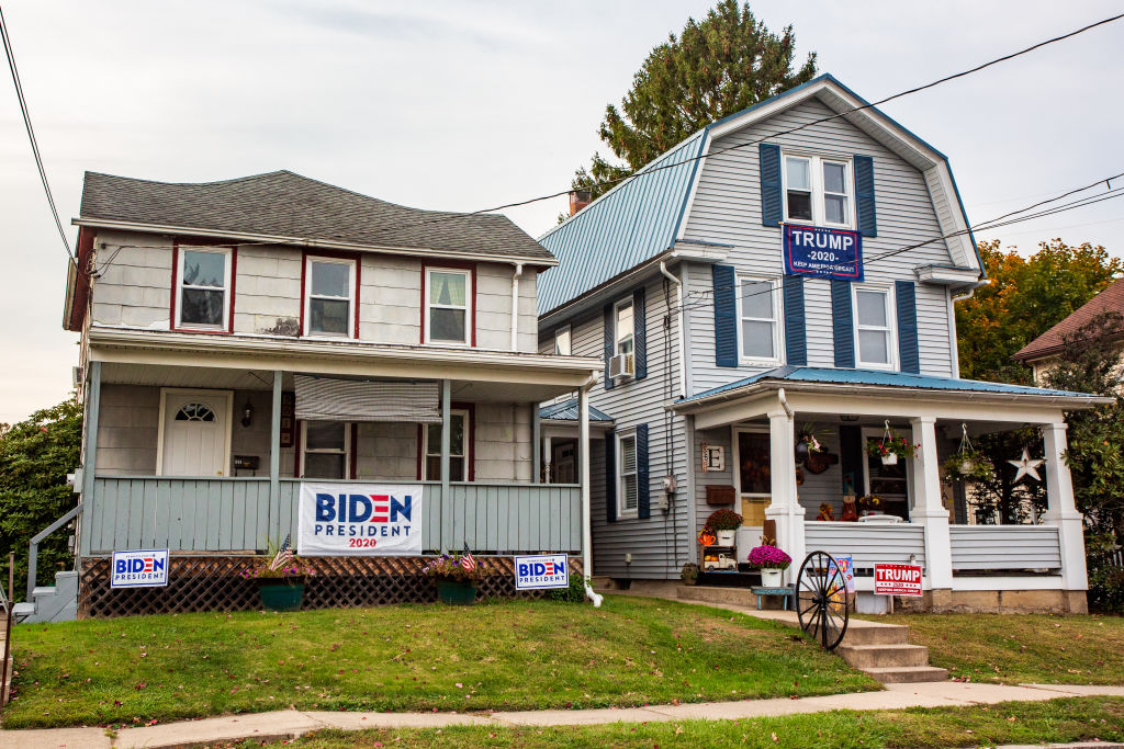 Neighboring houses display signs for opposing presidential candidates in Northumberland, Pa., a state being watched with great anticipation in the 2020 Election.