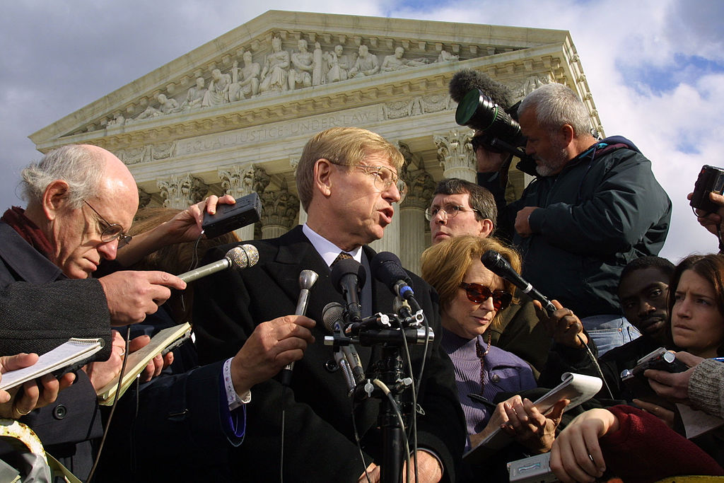 Theodore Olson, lead attorney for Republican presidential candidate Texas Governor George W. Bush, speaks to reporters outside the U.S. Supreme Court after oral arguments Dec. 1, 2000 in Washington, D.C.