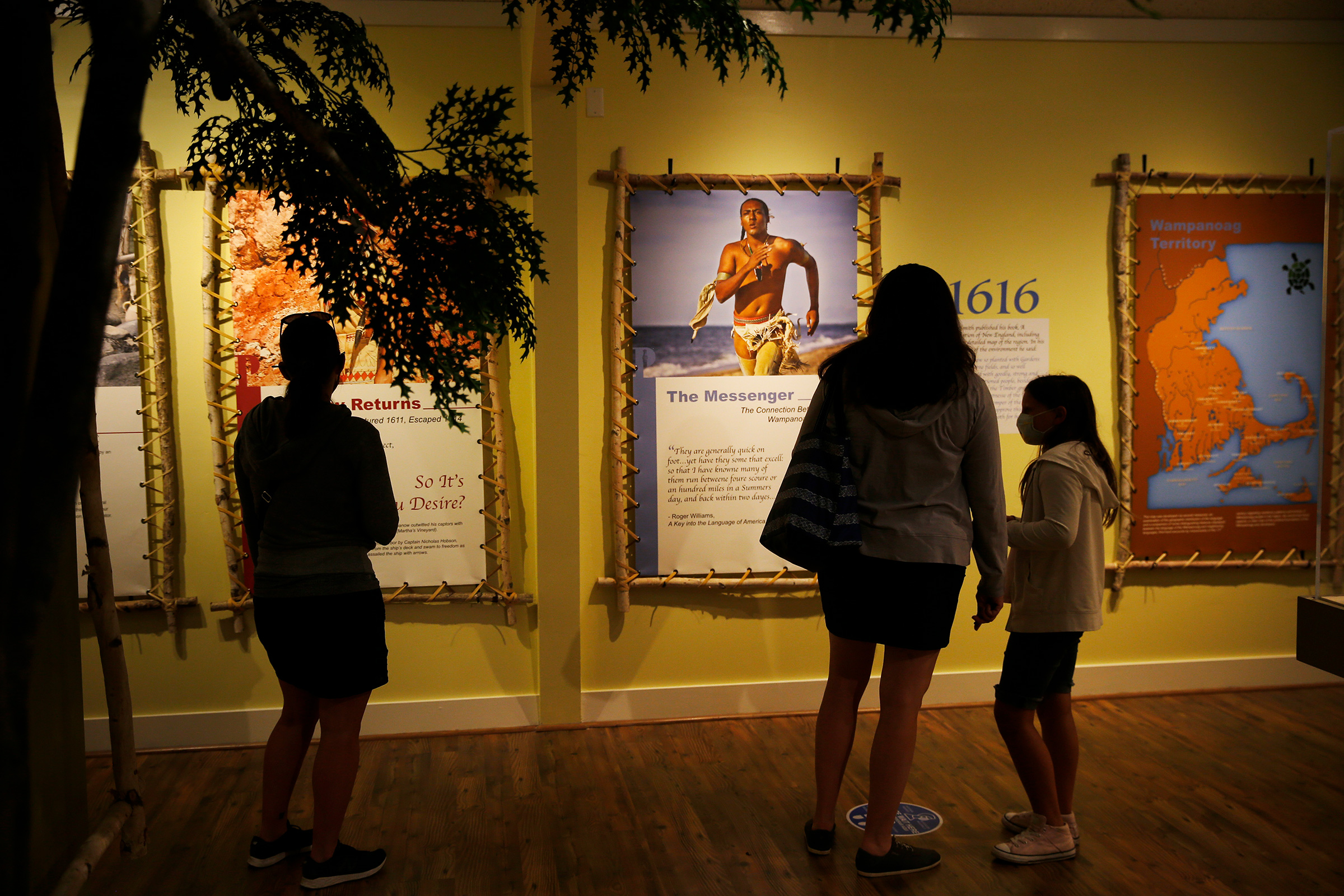 Visitors to the Pilgrim Monument and Provincetown Museum pause to examine a new exhibit about early interactions between the Pilgrims and the Wampanoag tribe in Provincetown, MA on Aug. 27.