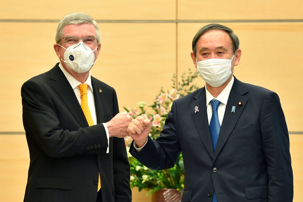 Japan's Prime Minister Yoshihide Suga, right, greets International Olympic Committee (IOC) president Thomas Bach during their meeting in Tokyo on November 16, 2020.