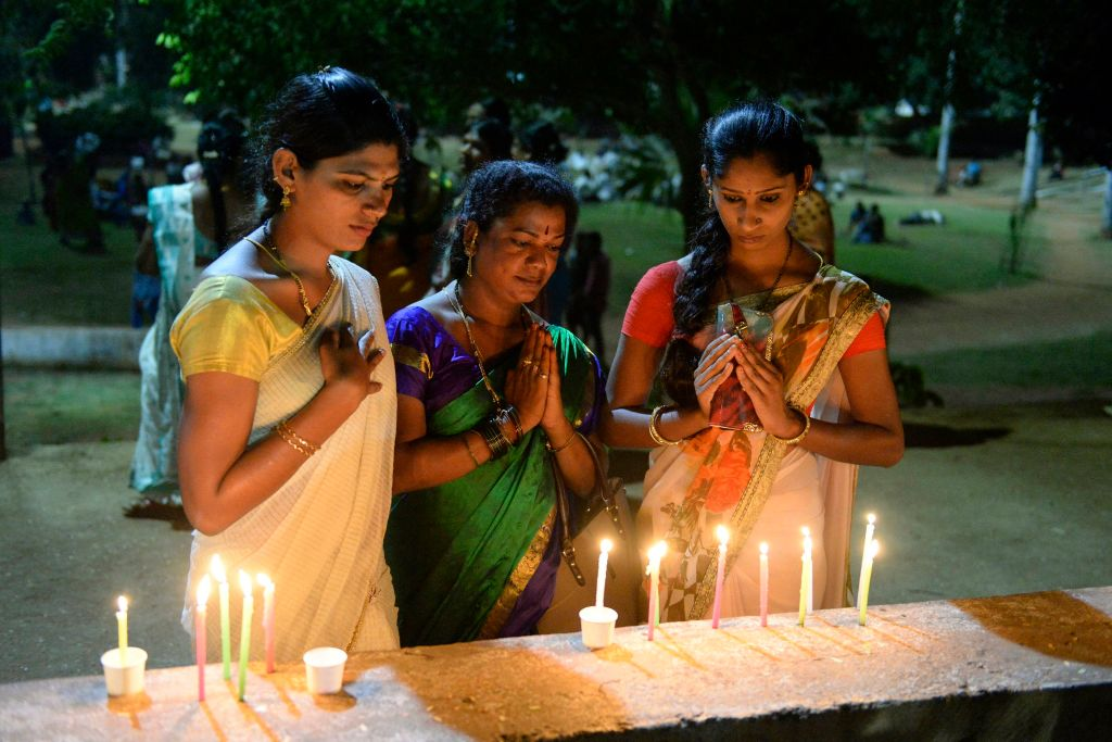 Members of the Telangana Transgender community hold a candlelight vigil to mark the 'Transgender Day of Remembrance', in Hyderabad on Nov. 20, 2019.