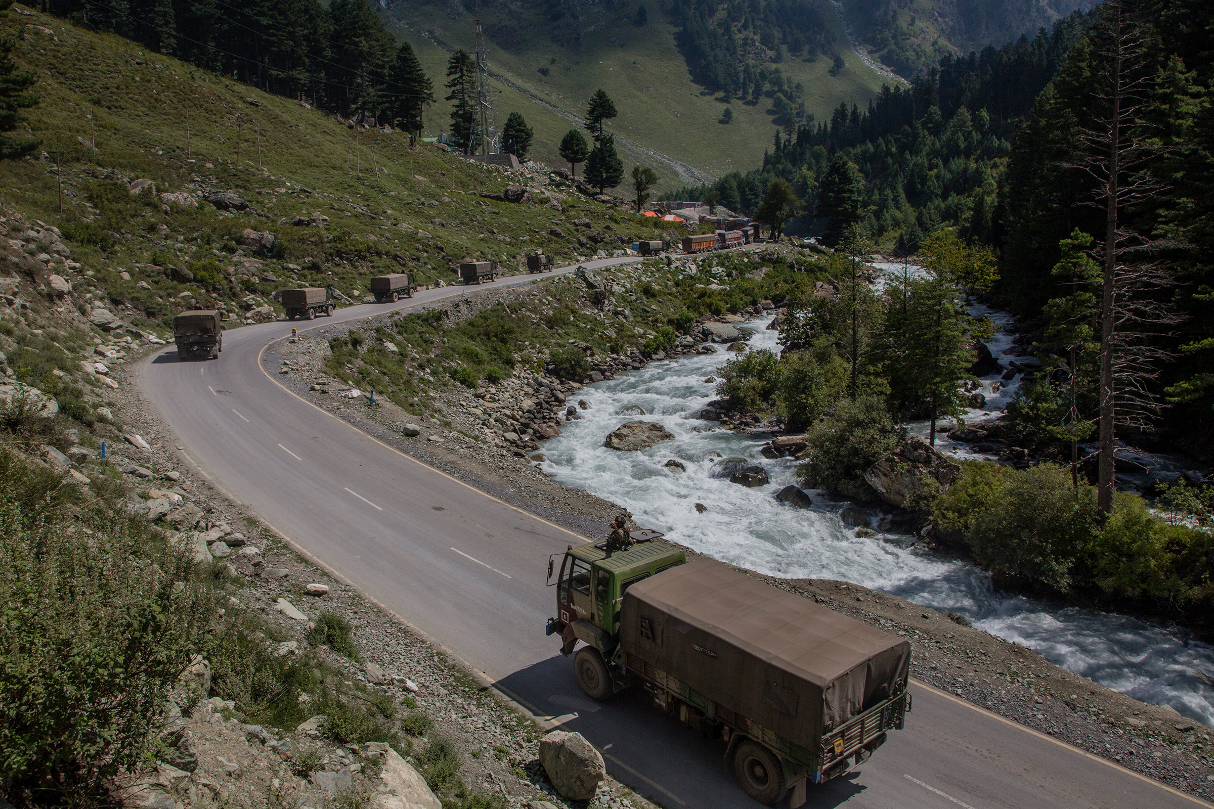 An Indian army convoy drives toward Leh, on a highway bordering China, in Gagangir, India, on Sept. 2.