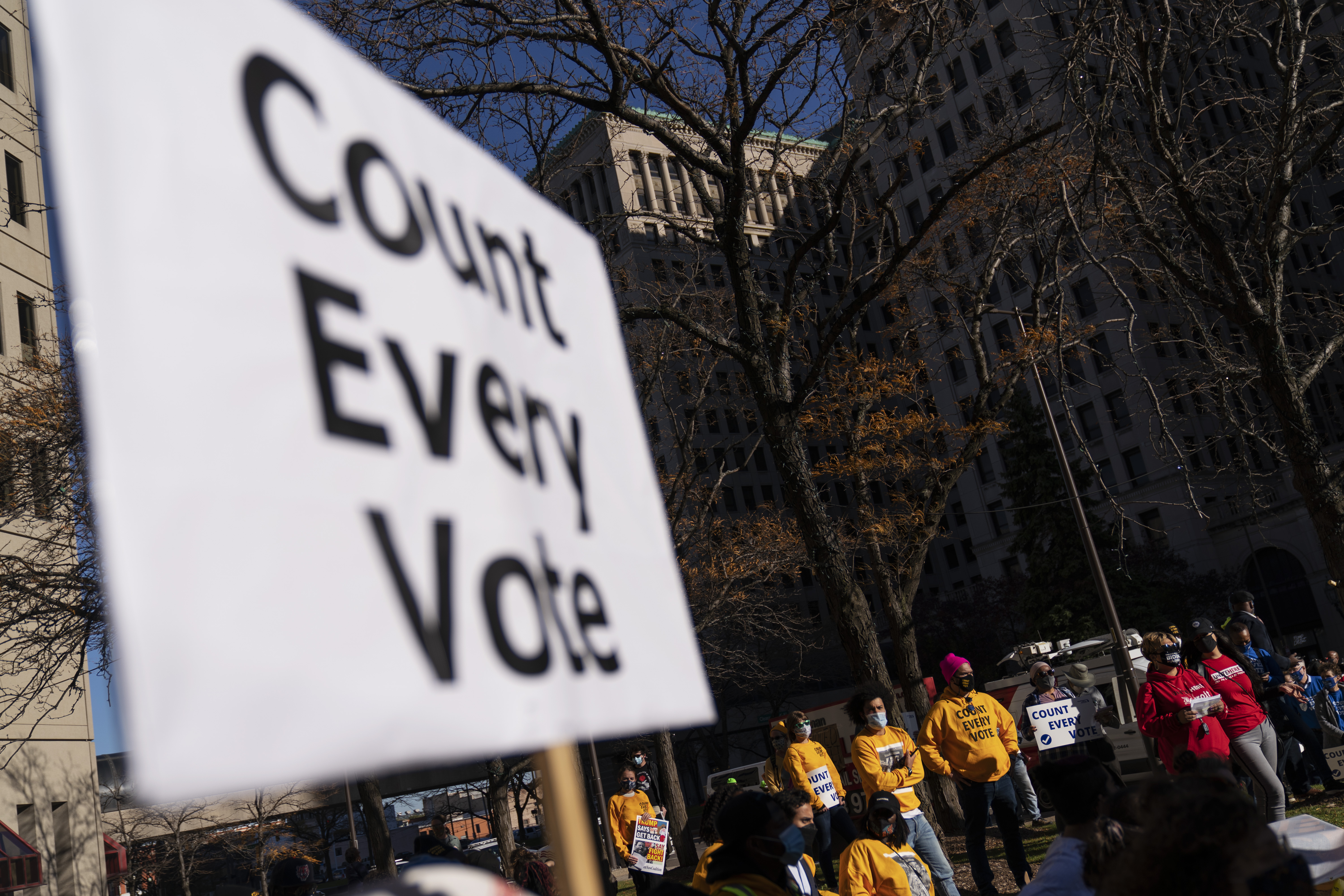In this Nov. 4, 2020, photo, protestors attend a rally calling for every vote to be counted from the general election near the Detroit Department of Elections building in Detroit.