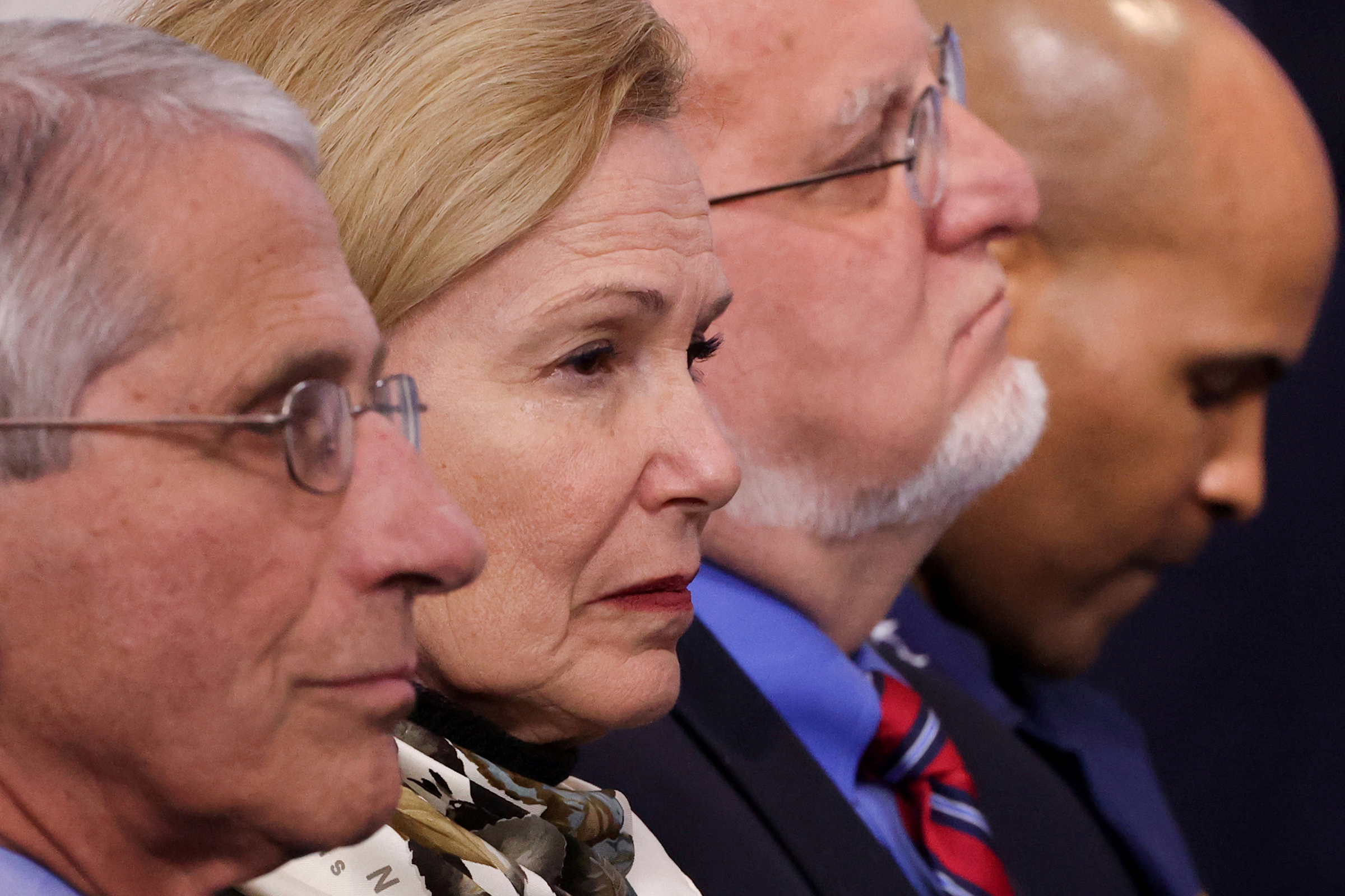 Members of the White House coronavirus task force—Dr. Anthony Fauci, Dr. Deborah Birx, CDC Director Robert Redfield and U.S. Surgeon-General Jerome Adams—listen to President Trump during a daily briefing at the White House in Washington, D.C., on April 22, 2020.
