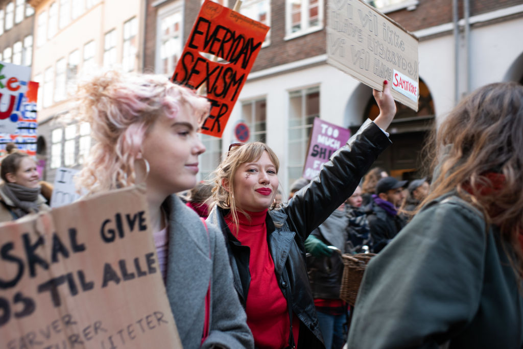 Demonstrators hold signs and march during a rally on International Women's Day from Frue Plads to Blagards Plads in the Norrebrogade neighborhood of Copenhagen, Denmark, on Friday, March 8, 2019.