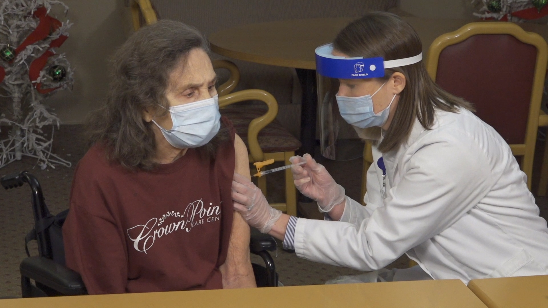 Pharmacist Kate Latta gives the Pfizer vaccine for COVID-19 to Rebecca Meeker, a 78-year-old resident of Crown Pointe Care Center in Columbus, Ohio, on Dec. 18, 2020.