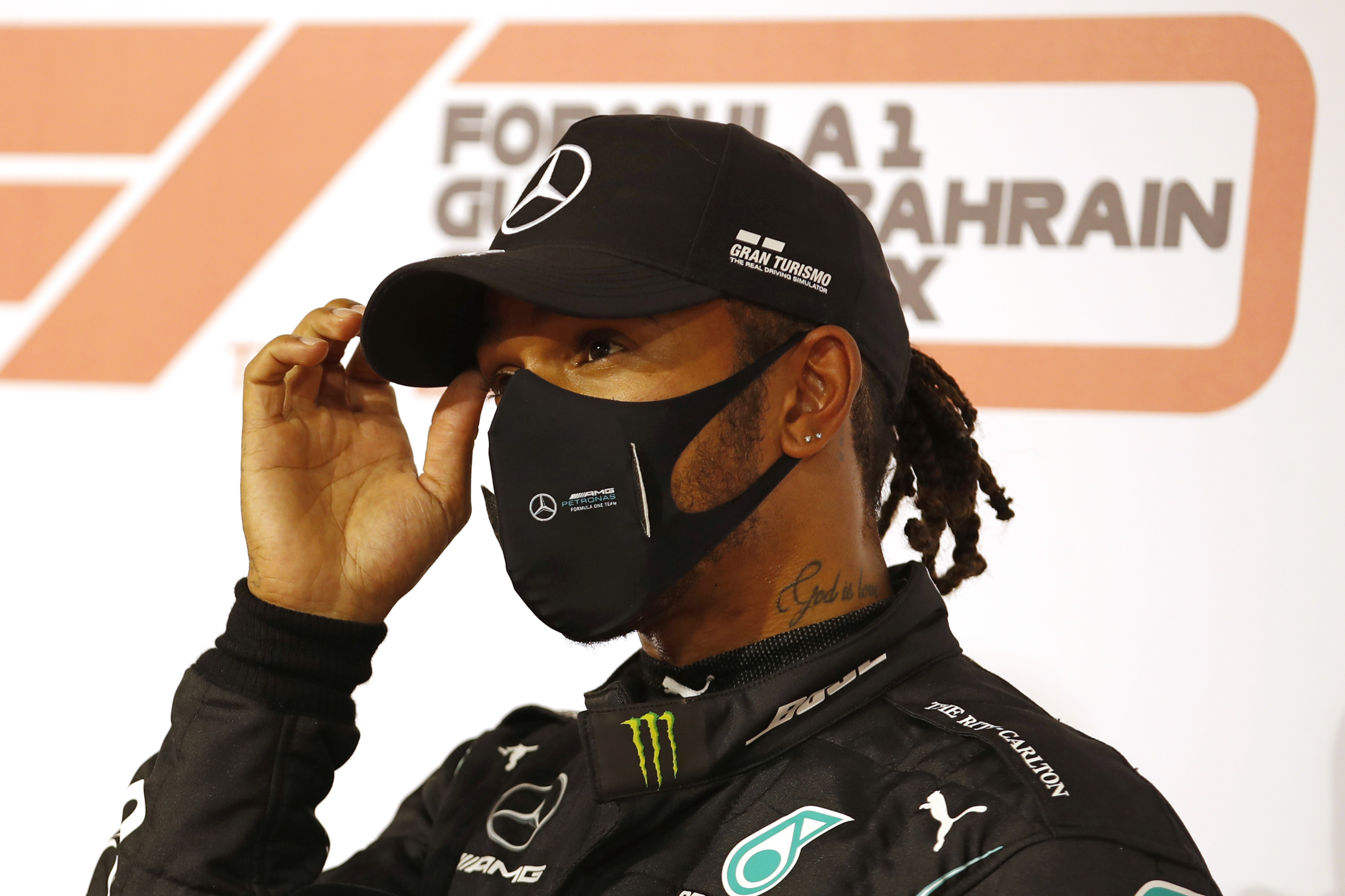 In this Saturday, Nov. 28, 2020 file photo Mercedes driver Lewis Hamilton of Britain gestures after taking the pole position after the qualifying session at the Formula One Bahrain International Circuit in Sakhir, Bahrain.